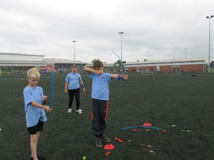 Aaron, Mollie and Layton taking part in the archery competition