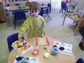 Exploring colour mixing and learning how to make paint from powder.