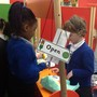 We set up our 'Fruit and Veg' stall for the children to role play. This encourages social and emotional development.
