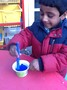 We added different coloured paints and glitters to our lollies.