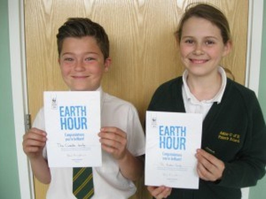 Year 6 children proud of their Earth Hour Certifcates