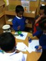 Children trying out the playdough challenges