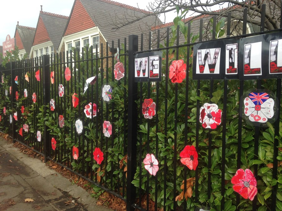 We Will Remember Them. We decorated poppies to hang outside our school.