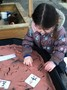 The children tried to copy the Chinese numbers in red sand