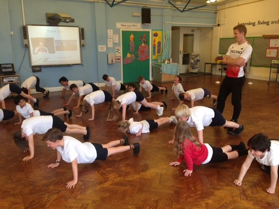 Daniel Gardiner, international long jumper, takes a PE session