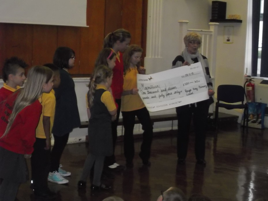 School Council presenting our cheque to Macmillan Cancer Support