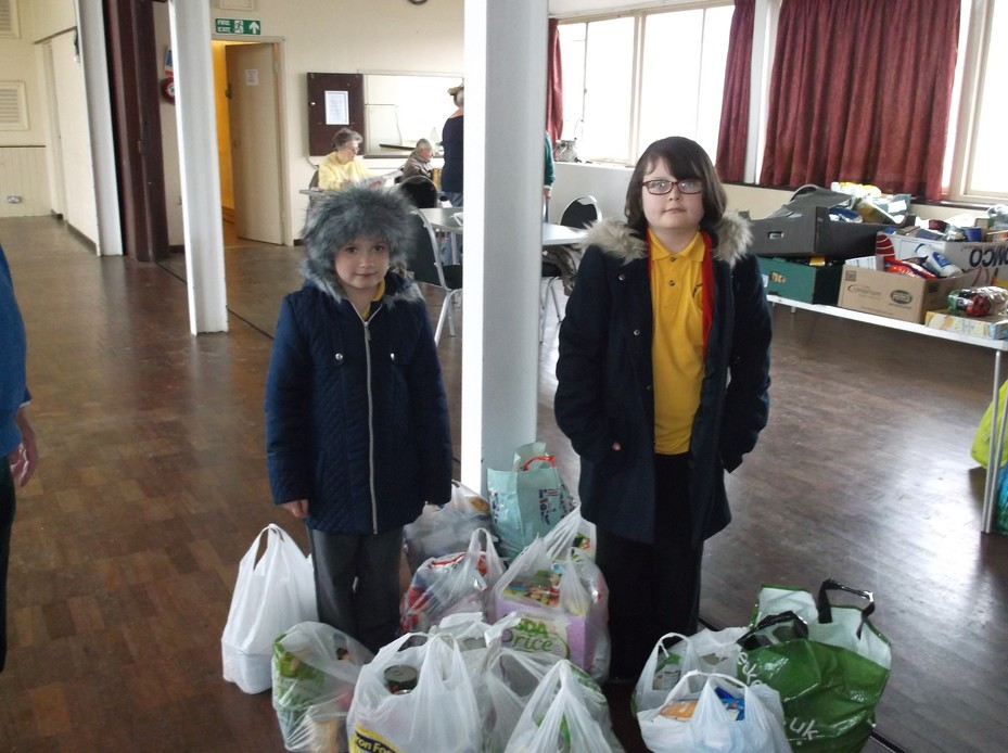 School Council sorting and delivering food to the local community.