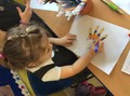 drew around our hands and decorated them with mehndi patterns,
