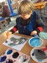 and experimented by mixing wintery coloured paints.