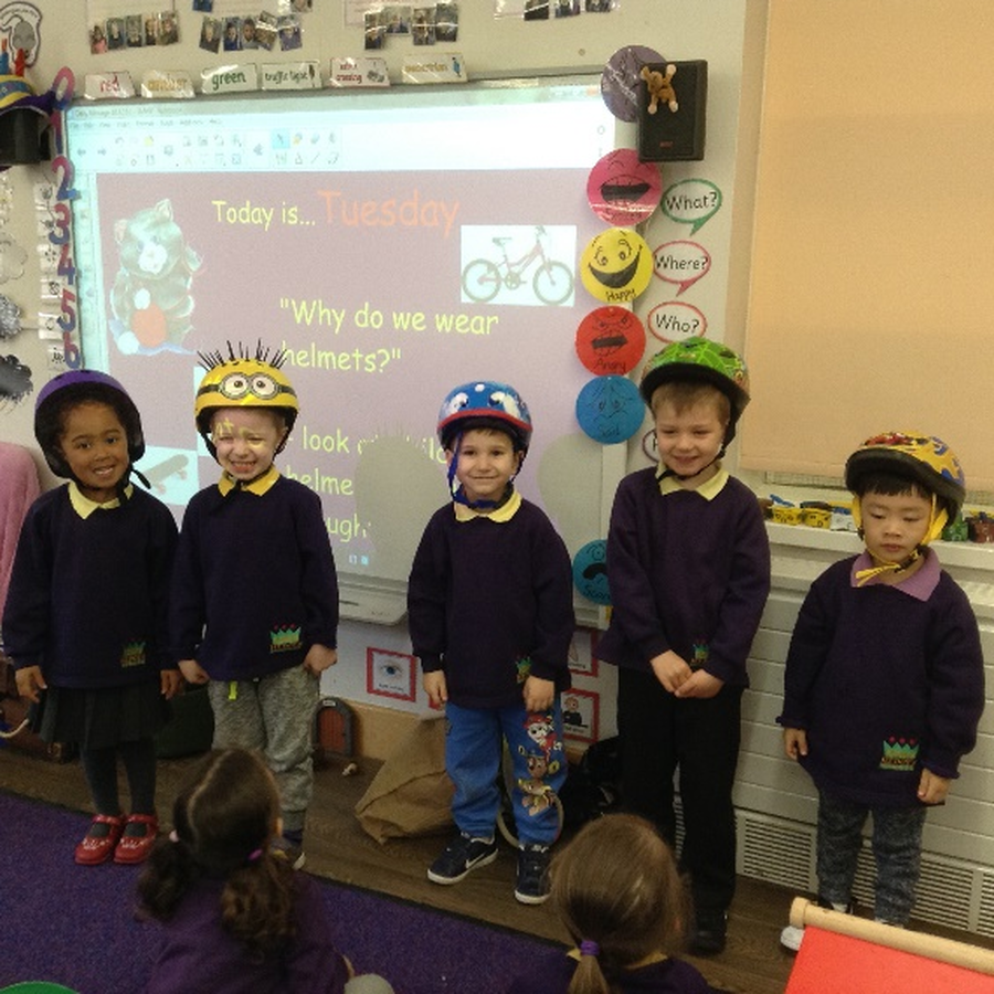 Nursery children talking about how helmets can protect heads