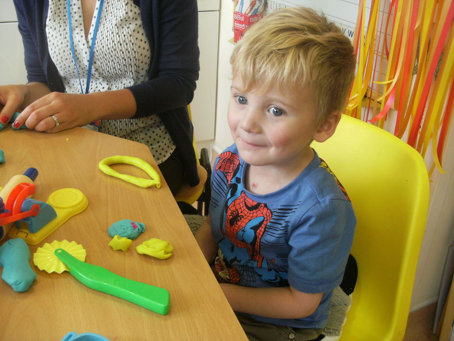 Sammy enjoying and working hard on his fine motor skills to help his emerging mark making abilities.