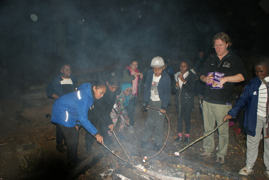 Toasting marshmallows on the campfire.
