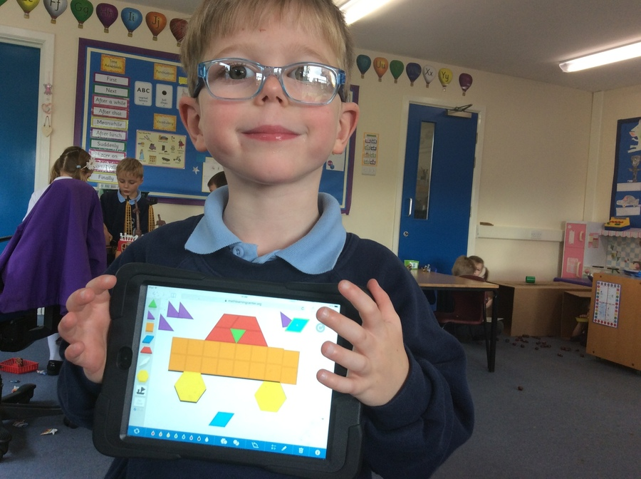 We made shape pictures on the iPads. Look at this careful work!