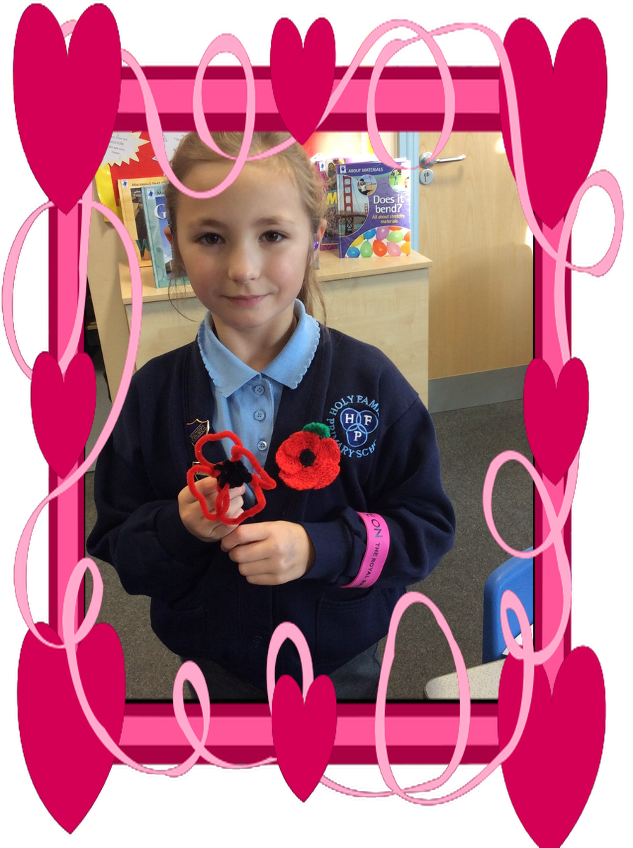 Antonia with her pipe cleaner poppy