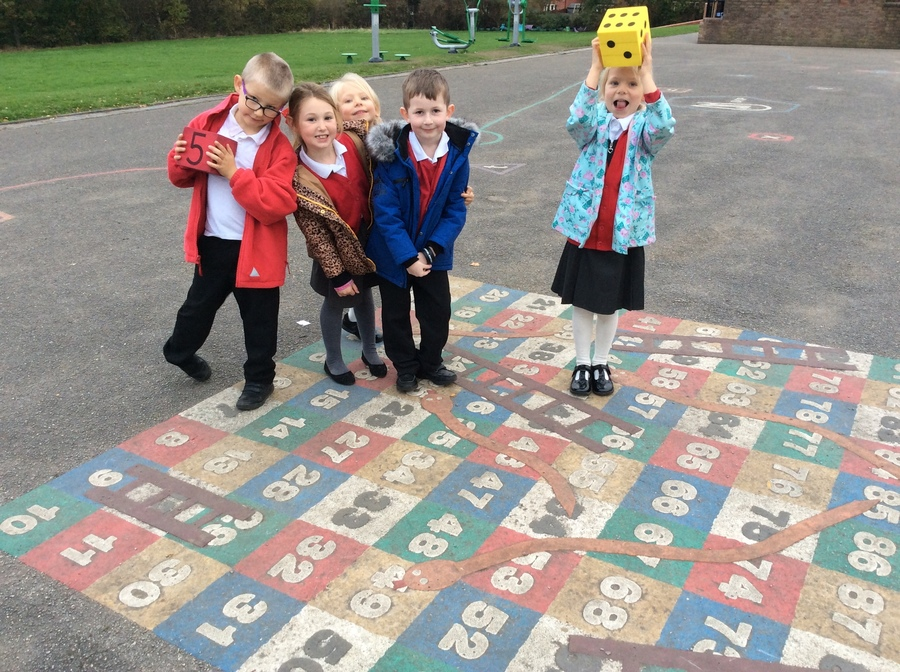 Snakes and ladders is a great way to learn addition and subtraction -especially outside.