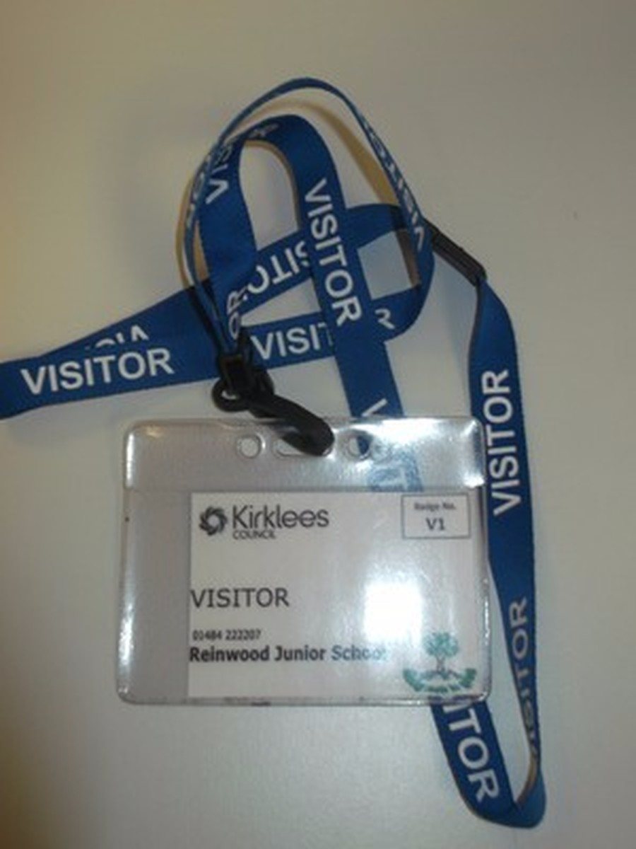Visitors wear a BLUE lanyard