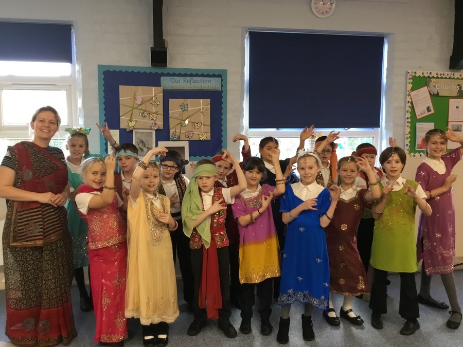 Class 3 enjoying traditional Indian dance and clothing