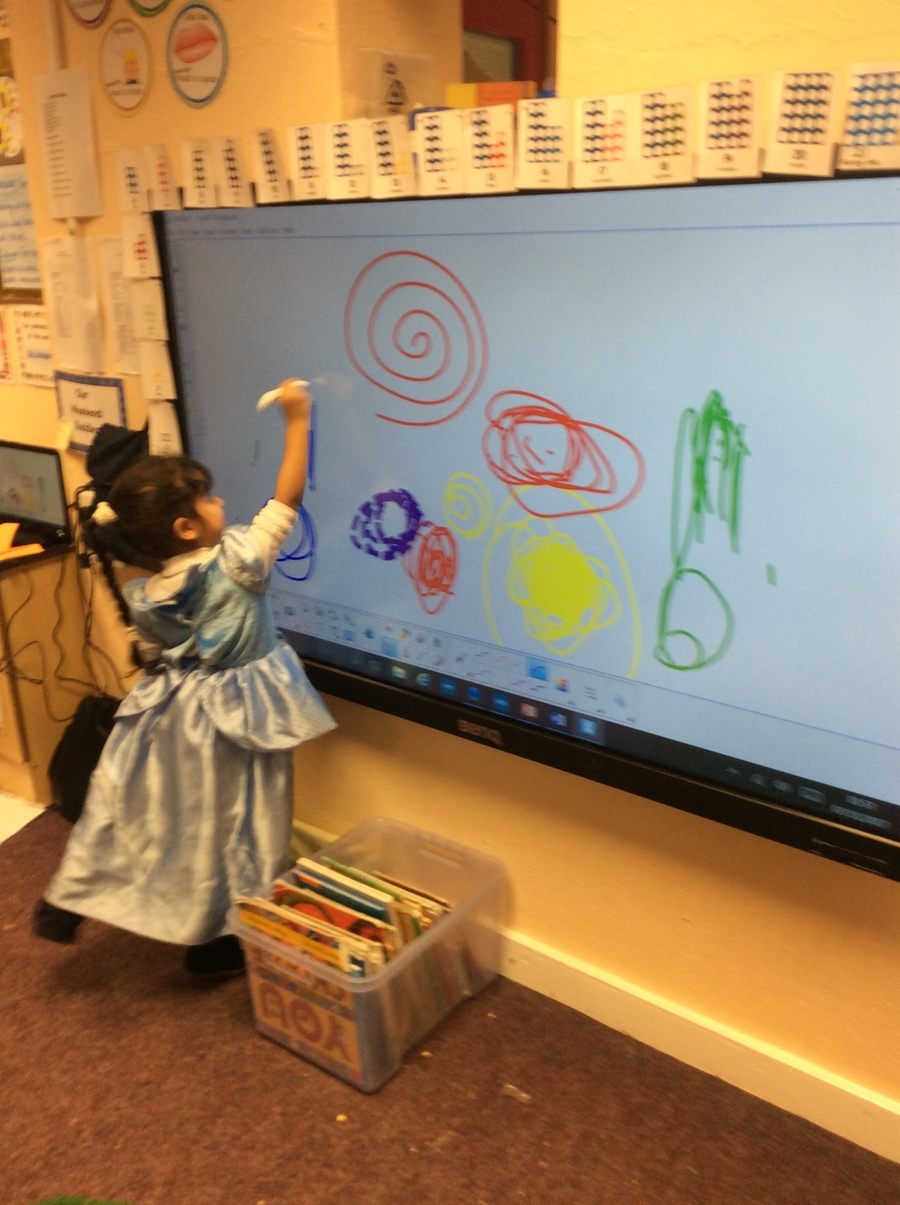 Creating marks on the interactive board to represent fireworks.