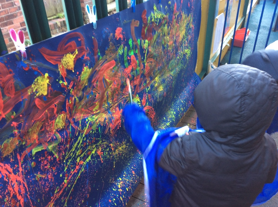 We painted large pictures of fireworks outside using a range of mark making tools.