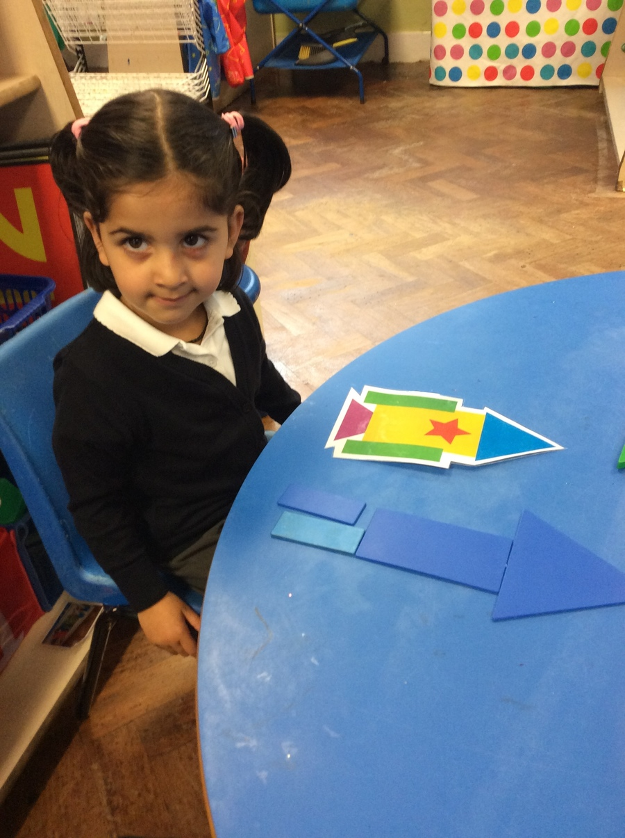 We have been learning to name and identify 2D shapes.  We used and arranged our shapes to make pictures of firework rockets.