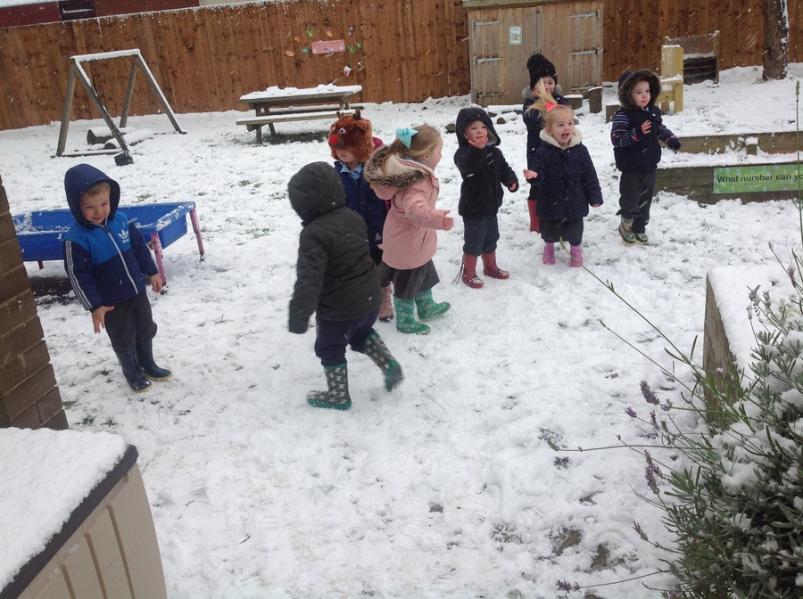 "Nursery children had lots of fun playing in the snow. They enjoyed making footprints and listening to the snow crunch. ""Look at my footprints."" Said Skyelar."
