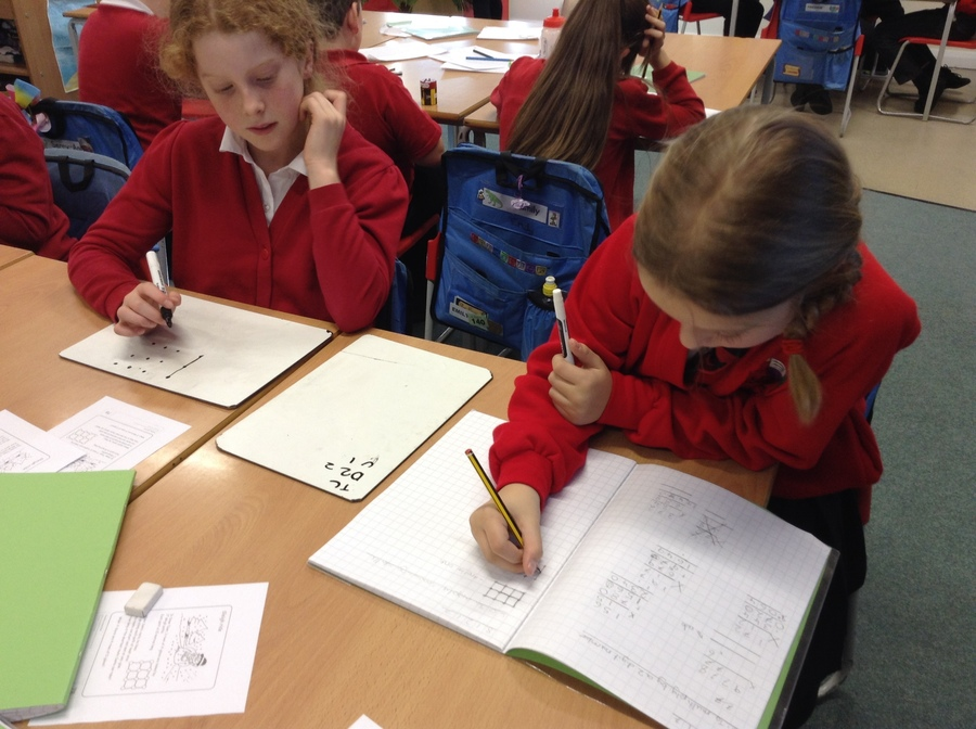 Working together to solve maths problems.