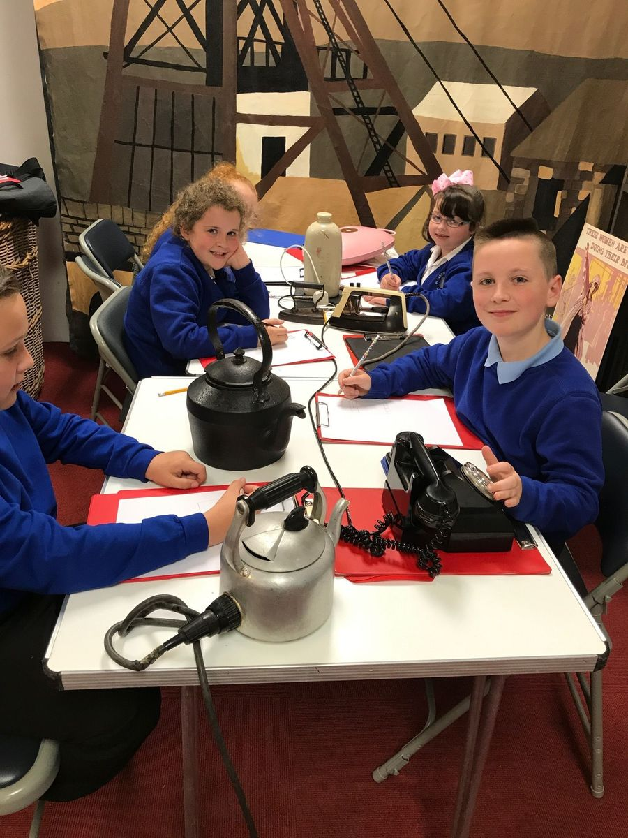 studying artefacts from the past at Swansea Museum
