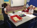 Using different resources to help us in Maths!