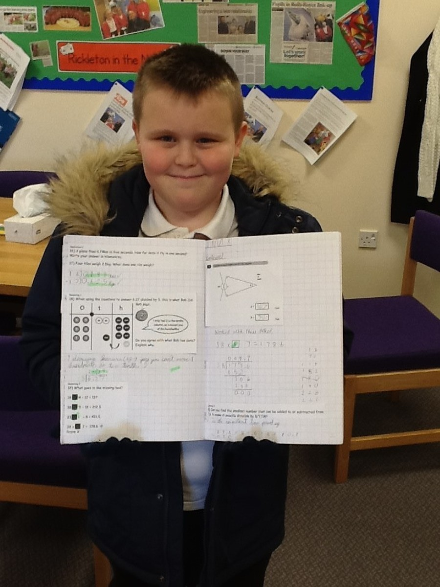Alfie has worked really hard in maths, learning to multipy a decimal number by an integer.  Well done Alfie!