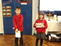 The first winners of the lunchtime awards, 1 child from Key Stage 1, 1 child from Key stage 2.