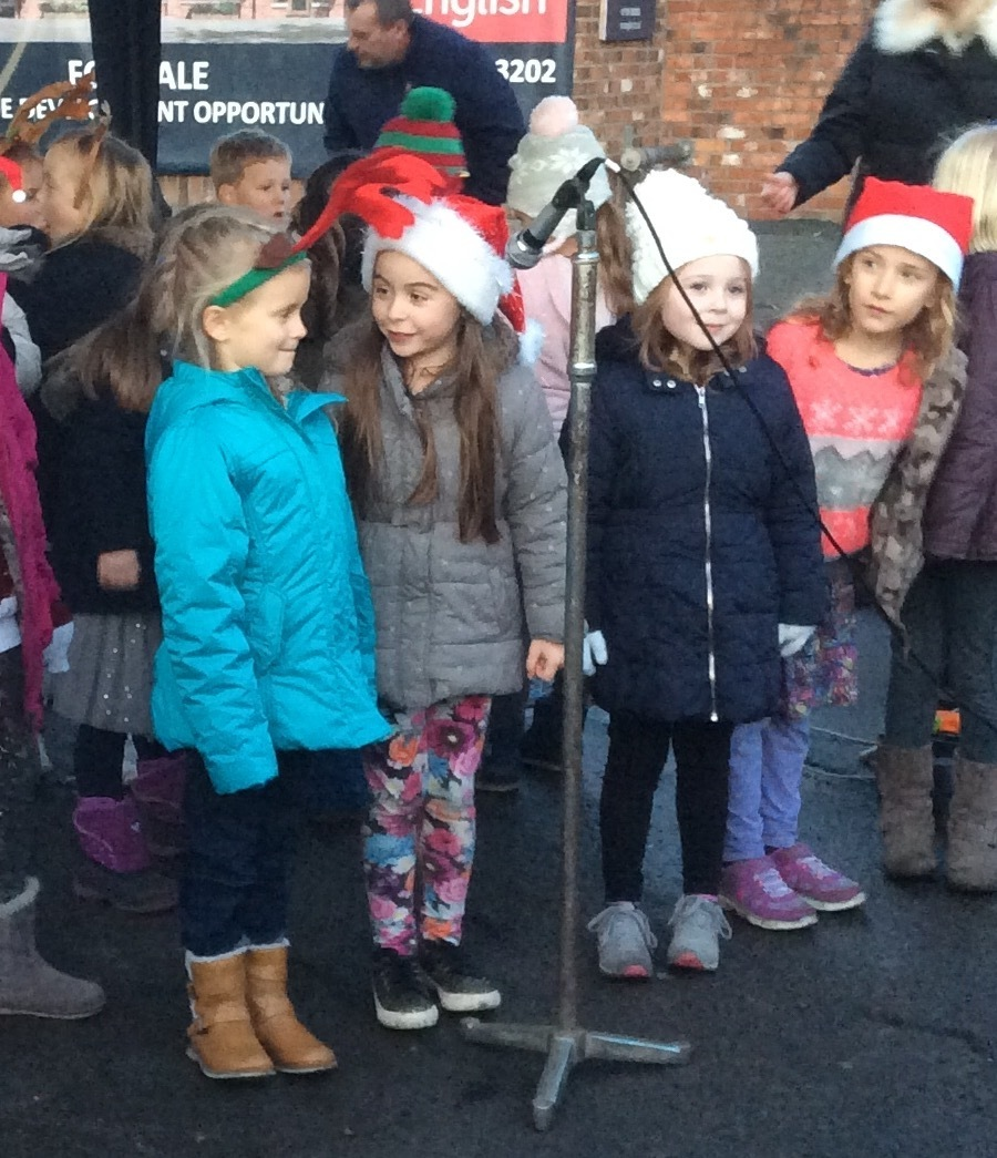 Singing in the village square at Christmas