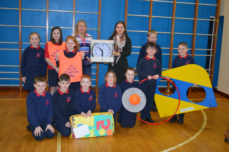 Representatives of the school council and PTFA committee with some of the play equipment and the outside clock requested by the council.