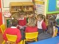 Foundation Stage children enjoying KS2  children sharing their work