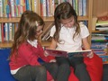 Sharing a book in the Library