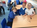 Making simple electric circuits.