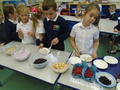Picking and mixing our porridge toppings!