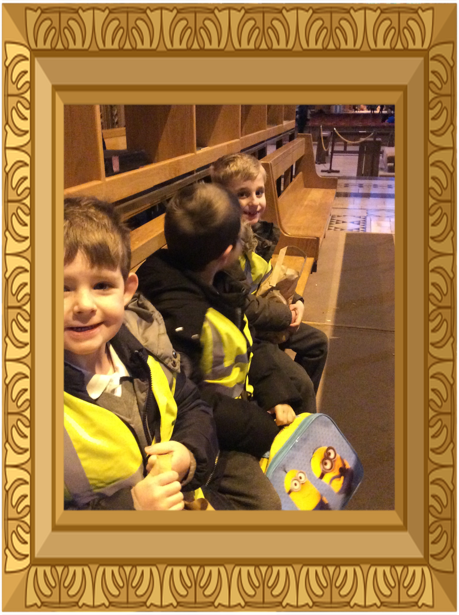 Year 2 pupils sitting on the pews in the Anglican Cathedral.