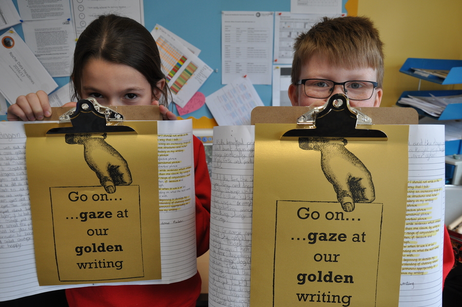 Writing that meets the Gold success criteria goes on display around school