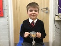George - Helping and working confidently in class. He is so enthusiastic about his learning - answering questions and explaining his learning.