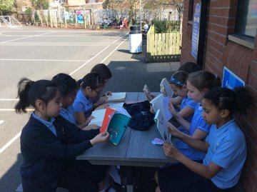 Independent reading outside in the shade!