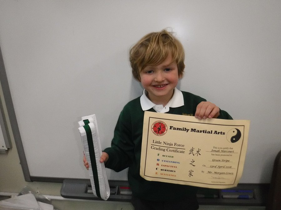Jonah is proud to show off his hard work which has earnt him his new green stripe belt and certificate in Tae Kwon Do!