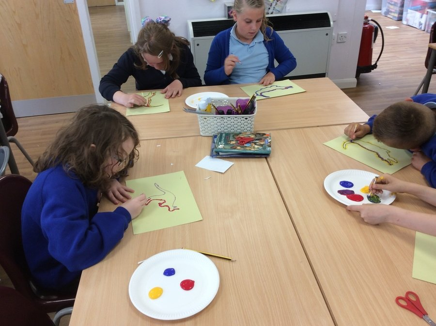 Mixing colours to create Australian Aboriginal art work using dot painting.