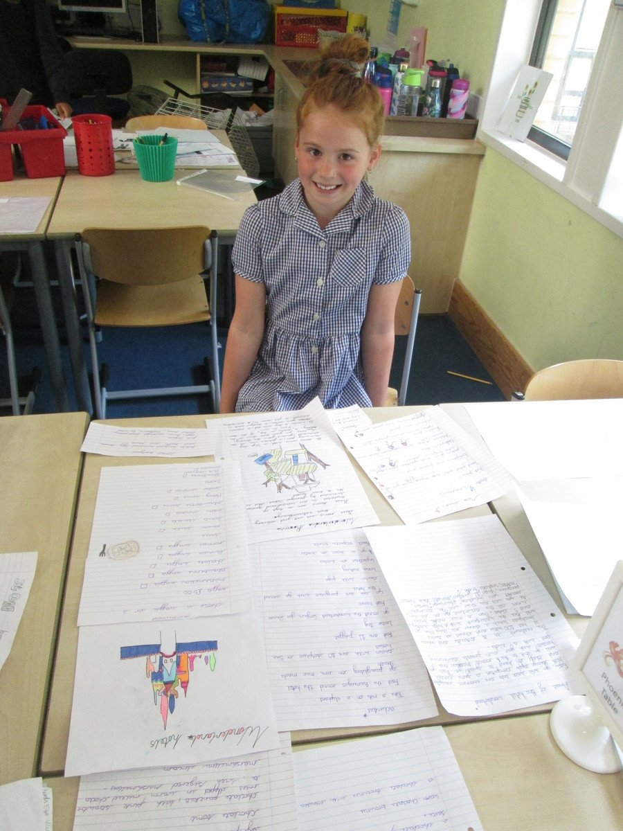 Year 5 worked do hard on their hotel projects. Here Isla proudly shows off her work.