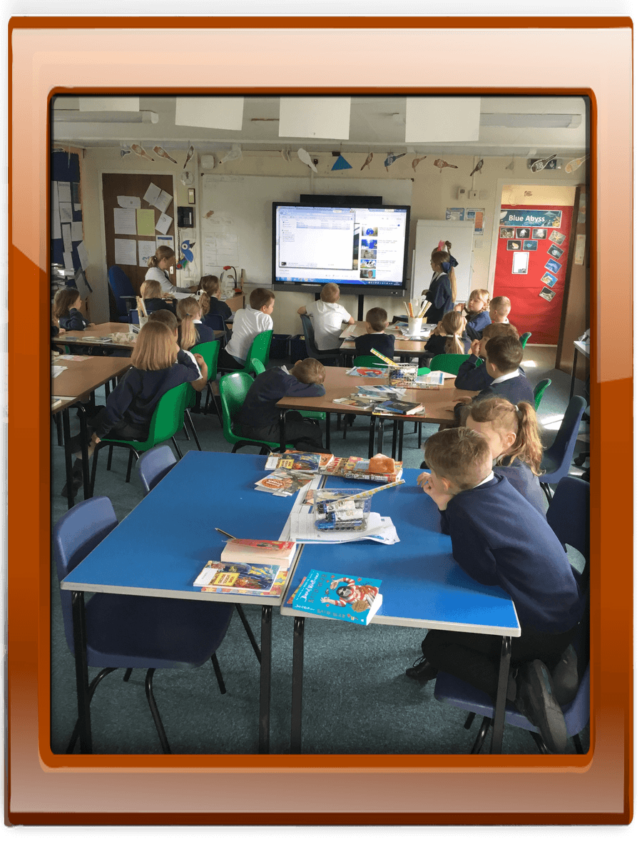 Year 4 girls presenting their power point on'Light and Dark'