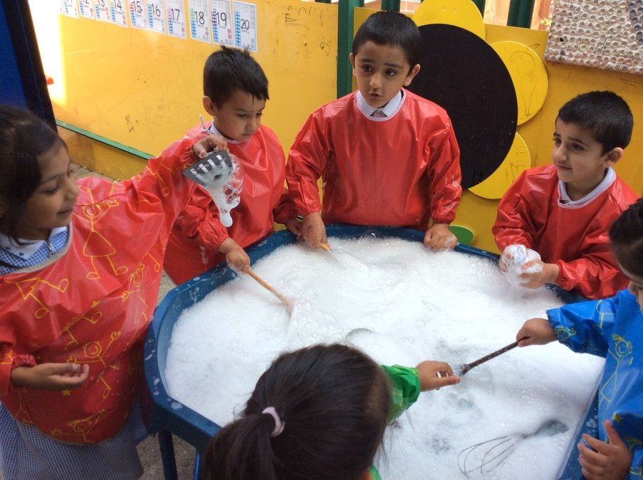 We enjoyed mixing and stirring water and soap flakes together to create bubbles, using a range of tools and equipment.