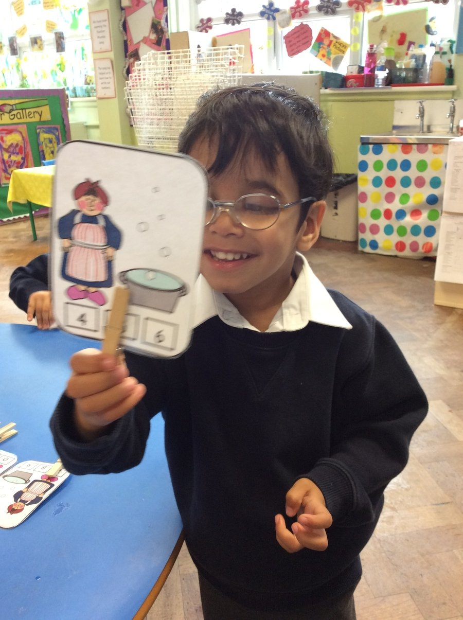 We counted the amount of bubbles on the Mrs Wishy Washy number cards, and then placed pegs on the matching numeral.