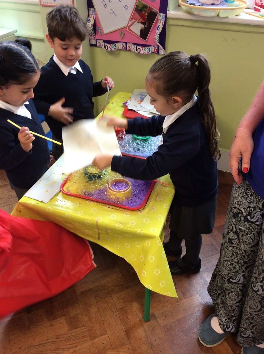 We created bubble blowing pictures using watery coloured paint and blowing through straws.
