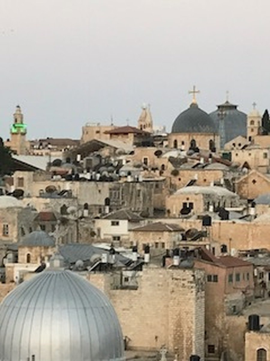 The dome with the gold cross is the Church of the Holy Sepulchre
