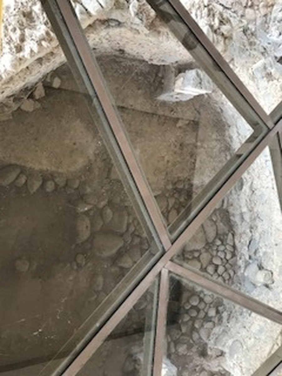 Under a modern church is the home of Peter and Andrew. A judgement based on it being the only plastered room in a 1st century house, where a change in pottery took place from domestic to votive oil lamps and other more sacred things.