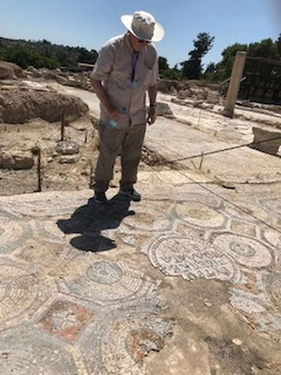 """Nick deciphers a Greek script - Paul in Roman days """"Pay your taxes""""."""